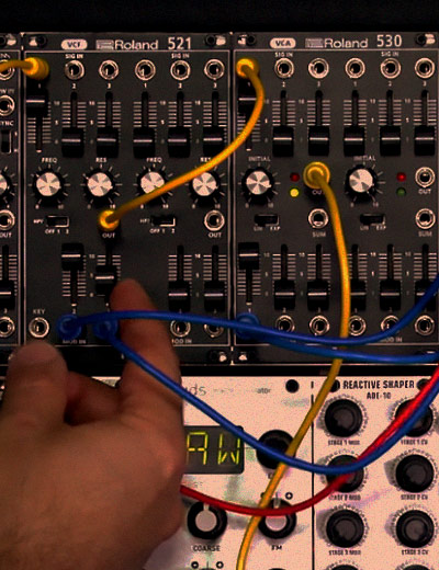 hands over modular synthesizer